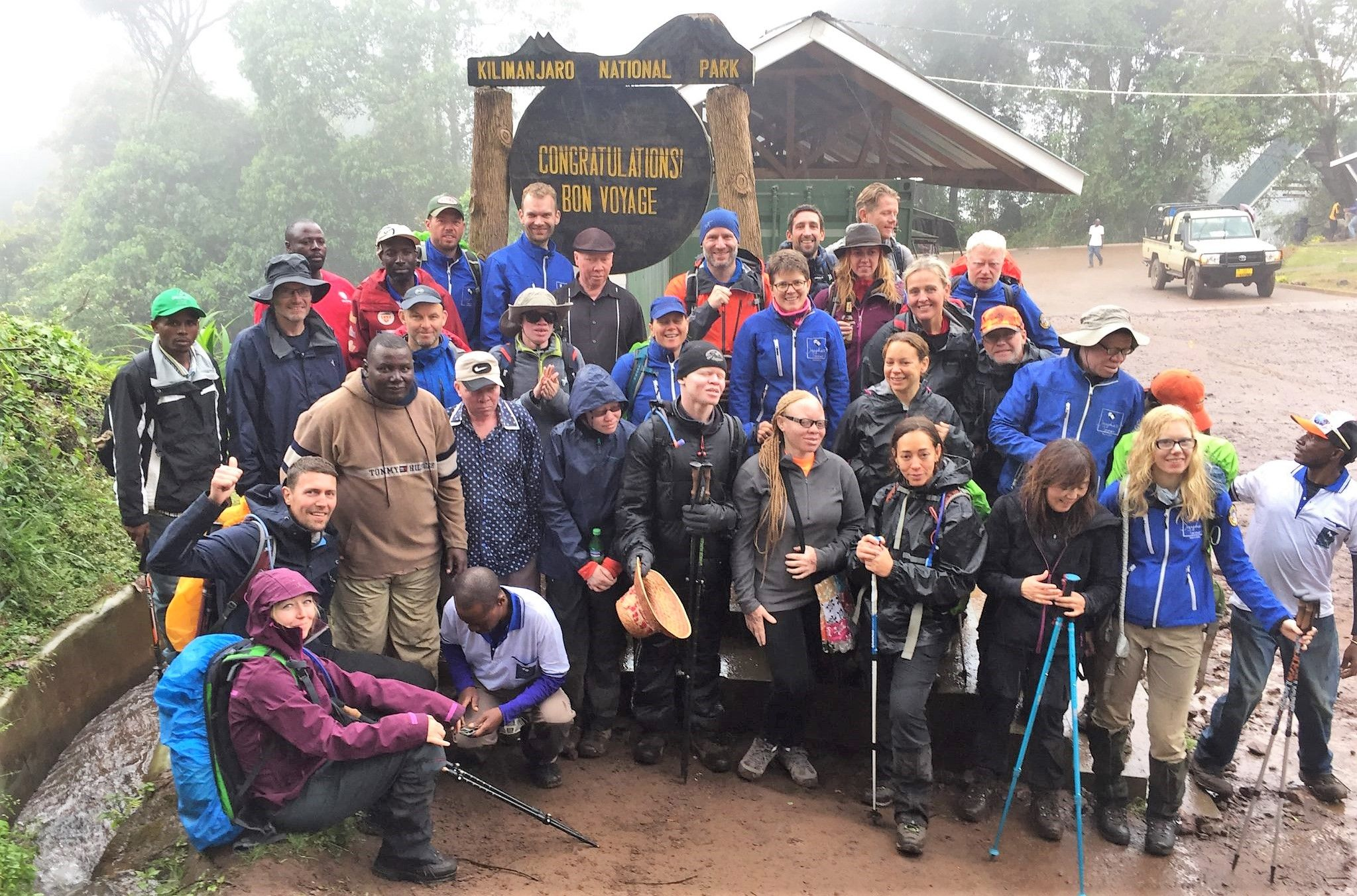 International group of 24 people before climbing mount Kilimanjaro